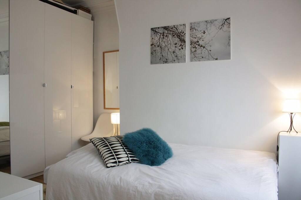 bedroom with big wardrobes