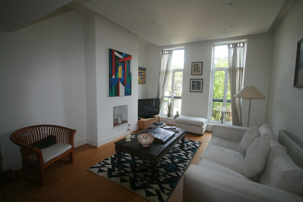 Light airy sitting room with full height opening windows. Plasma TV with freeview channels.