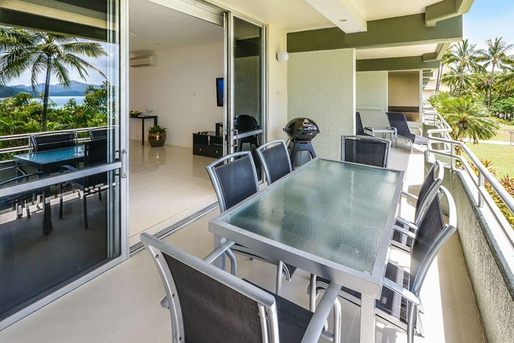 Large Balcony with six seat outside dining and two sun lounges & BBQ