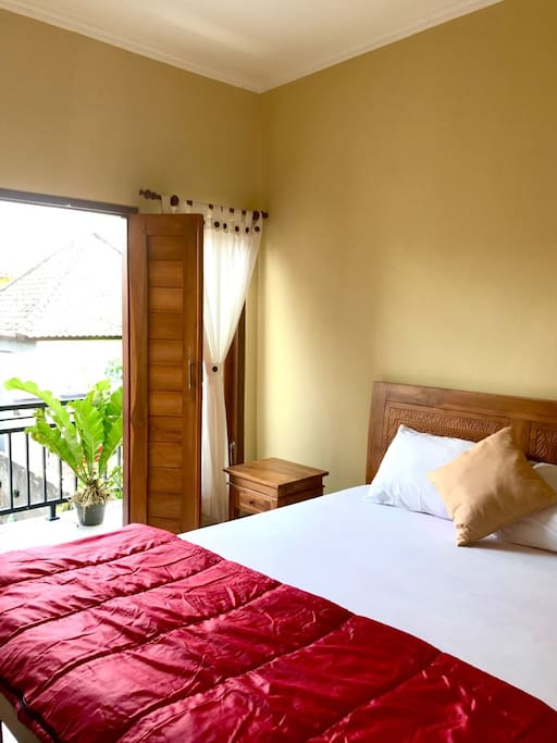 This is a private bedroom, with a balcony, ensuite bathroom, and air conditioning