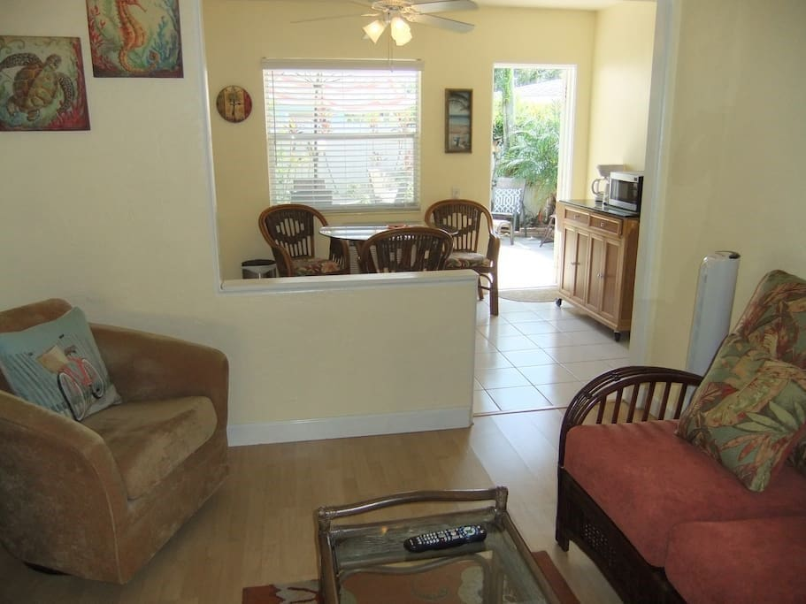 Open-concept living/dining areas. Back door leads to patio.