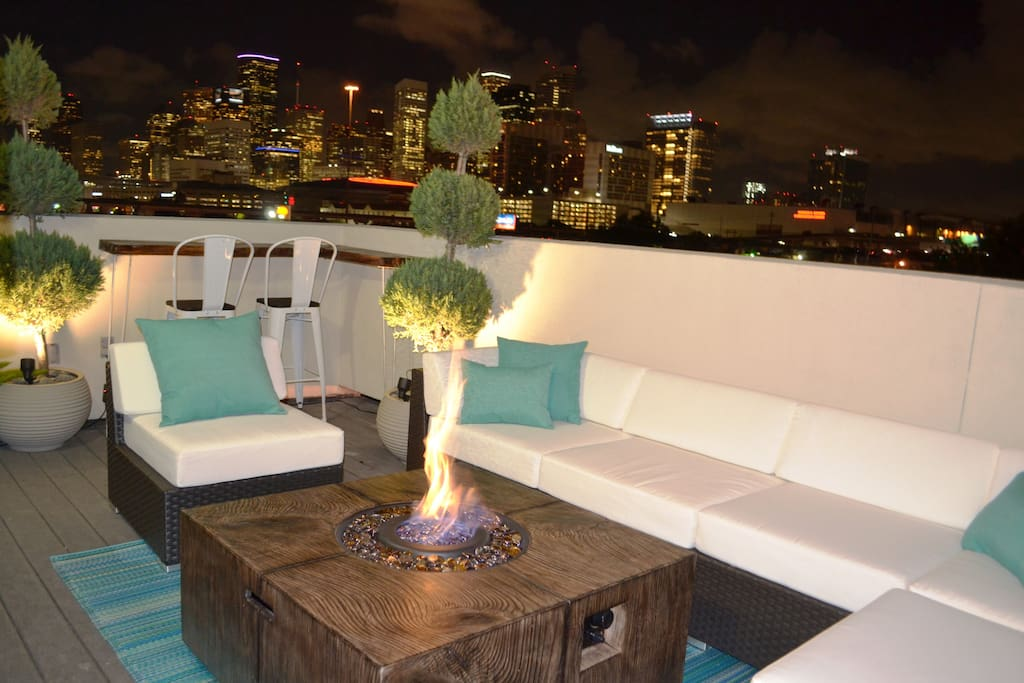 Beautiful fire table is perfect for evenings on the roof deck!