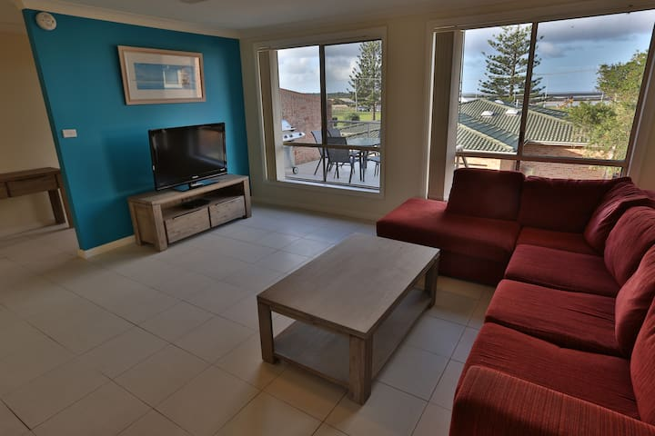 Lounge room with views to the park, lake and ocean