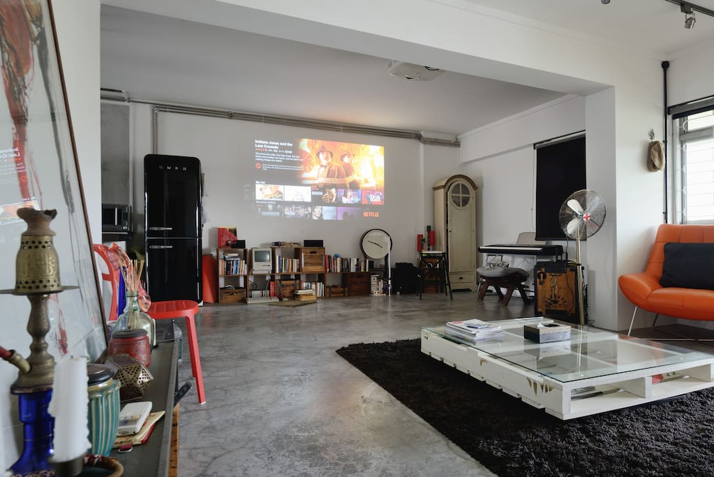 Living room with projector so you can watch movies like in a theatre!