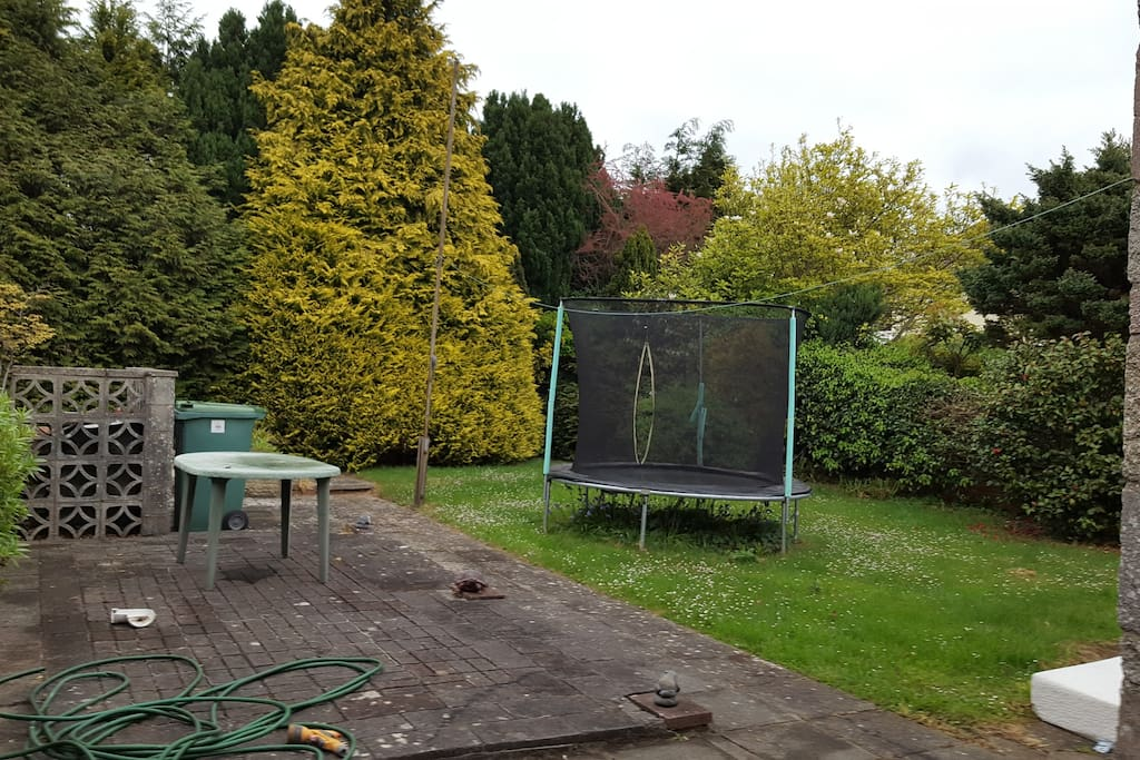 Back garden with raised patio area. Feel free to use the trampoline! (Or trampoline can be removed upon request)