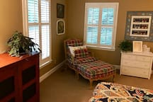 Enjoy the comfy chair and ottoman to read and relax!