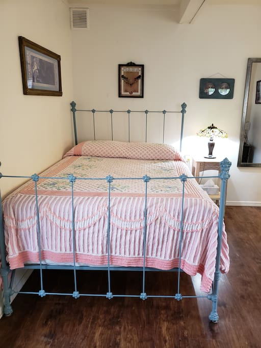 Vintage Iron Bed (with Full-sized Mattress) and bedside stained glass lamp