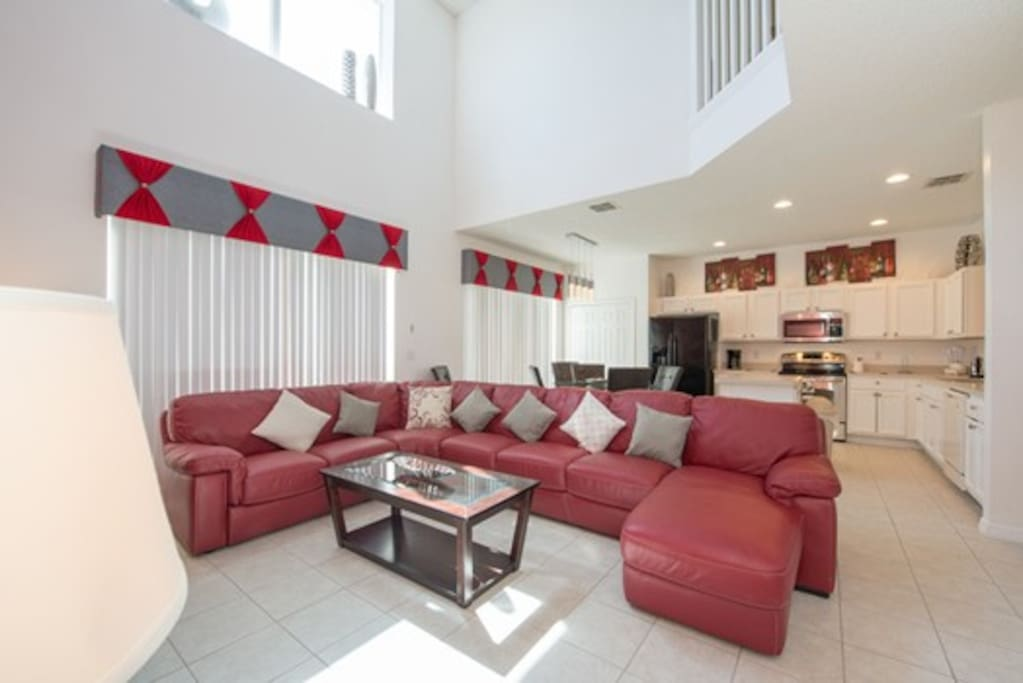 """Family Room Adjacent to the kitchen is the family room, which has ample seating with a beautiful leather sofa, new 65"""" Smart TV with surround sound, DVD player and Stereo."""