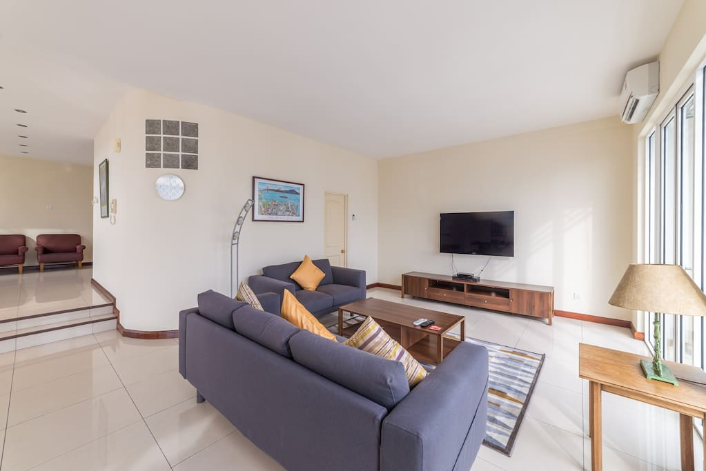 Spacious lounge with full satellite TV channels