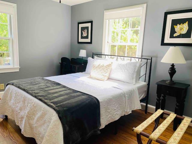 """Bedroom #2. Sleep comfortably in our 12"""" memory foam queen mattress."""