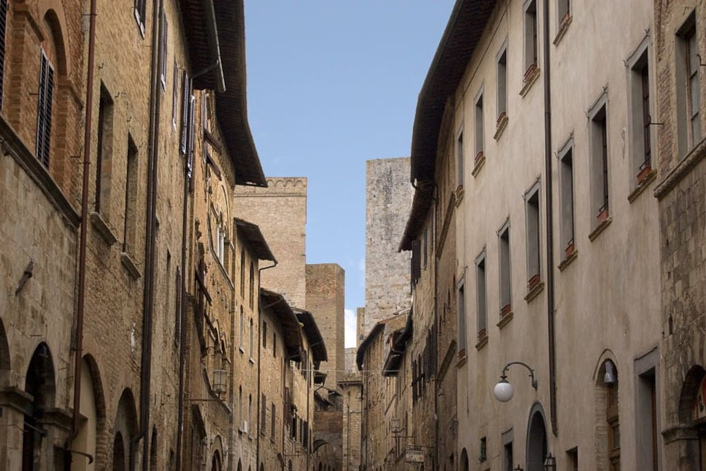 we are in the main street San Matteo, very good location, near the towers, museum, cathedral.