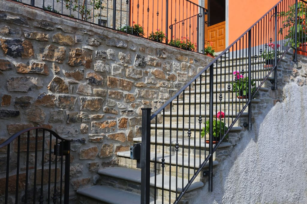 Beautiful gated Tuscan stone stairs with entry light