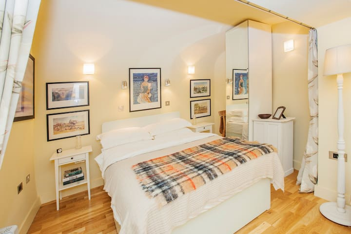 The sleeping area can be closed off from the living area by floor to ceiling curtains for more privacy.