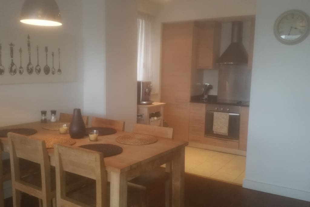 Open facing kitchen and 6 person dining set.