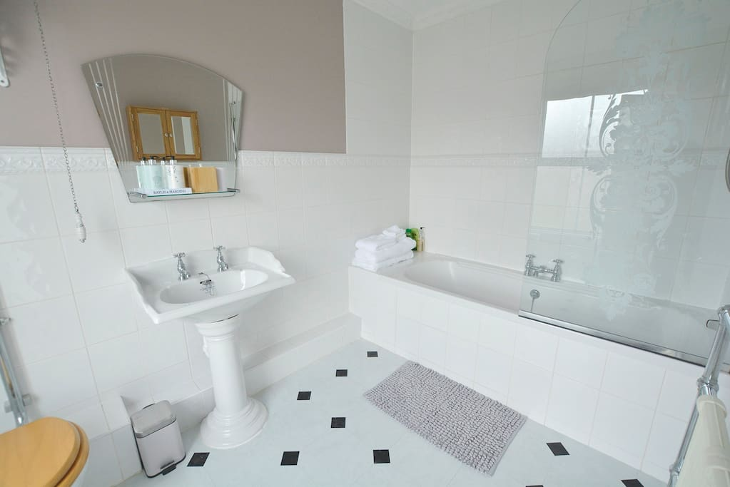 Your private bathroom with double bath, shower and toilet.