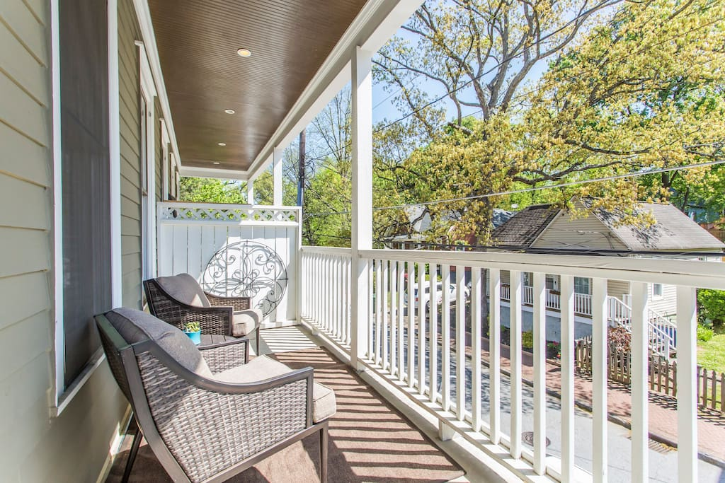 A relaxing porch off of the living room to take in the neighborhood.
