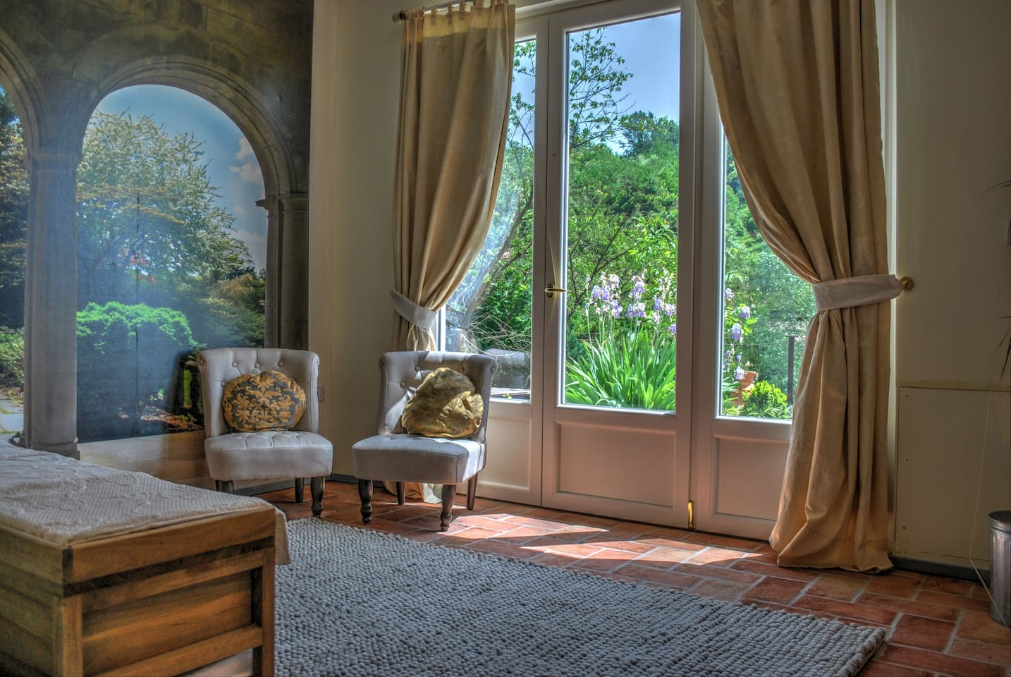 A light airy and cool room, decorated in traditional style; step out the door to enjoy the deck and garden.