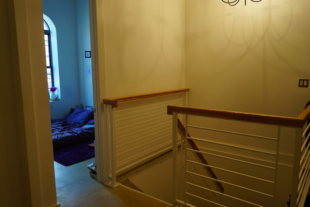 Stairs down to three other bedrooms