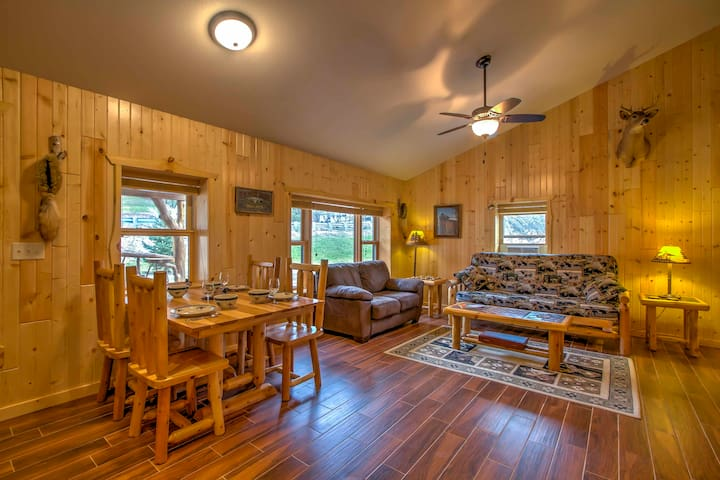 This cabin features vaulted ceilings and natural wood for a rustic theme.