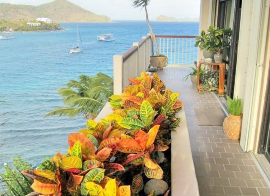 Enjoy drinks on the balcony overlooking the ocean and islands (including a views of St John and Tortola).