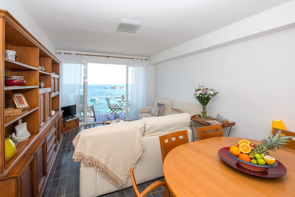 Spacious living and dining room with amazing views of sea and beach