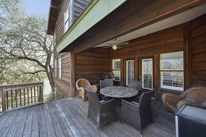 A grill and outdoor dining on the large wooden deck