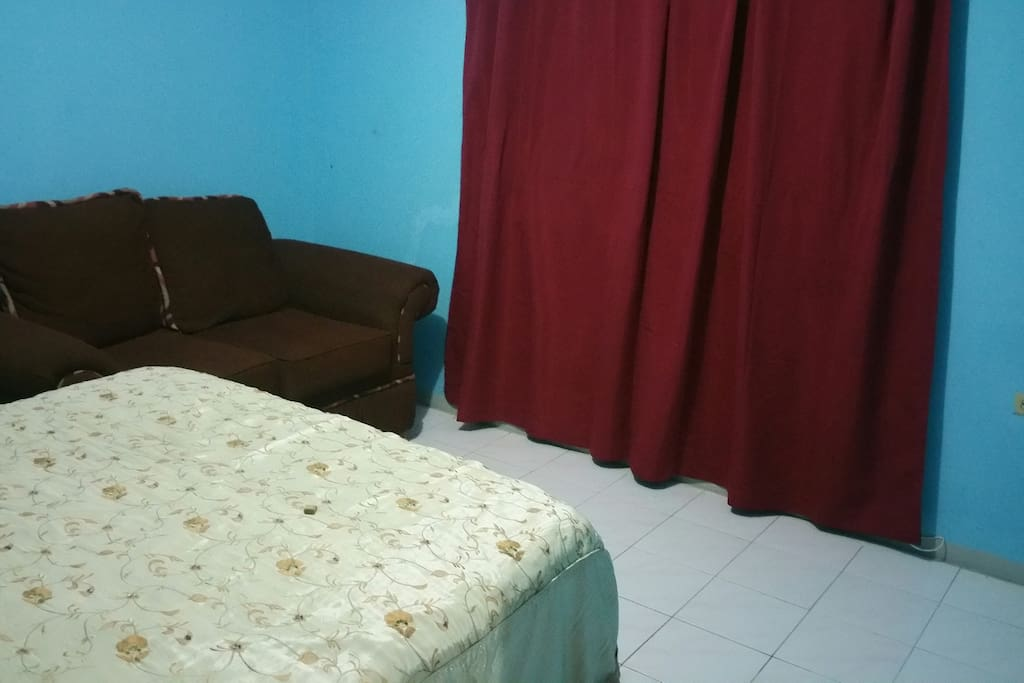 Small couch within the bedroom