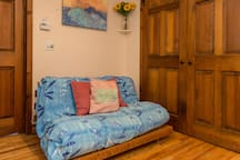 Extra Futon with frame in main room.