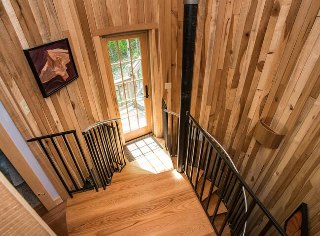 Spiral staircase in silo from yoga studio to apt.