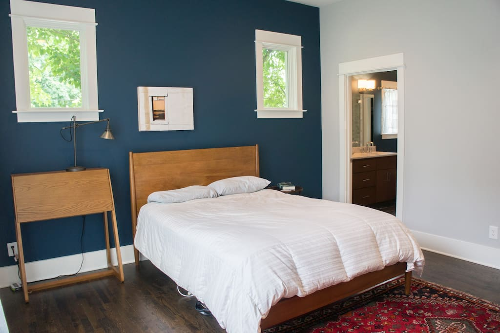 Master bedroom with queen bed. Private bathroom.