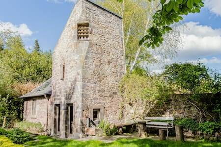 16th Century Dovecot Cottage in Private Garden.