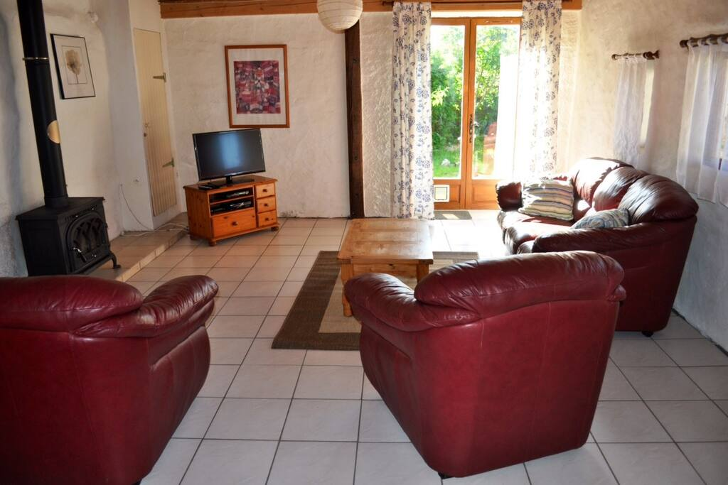 Spacious living room with woodburner and access to a small private garden