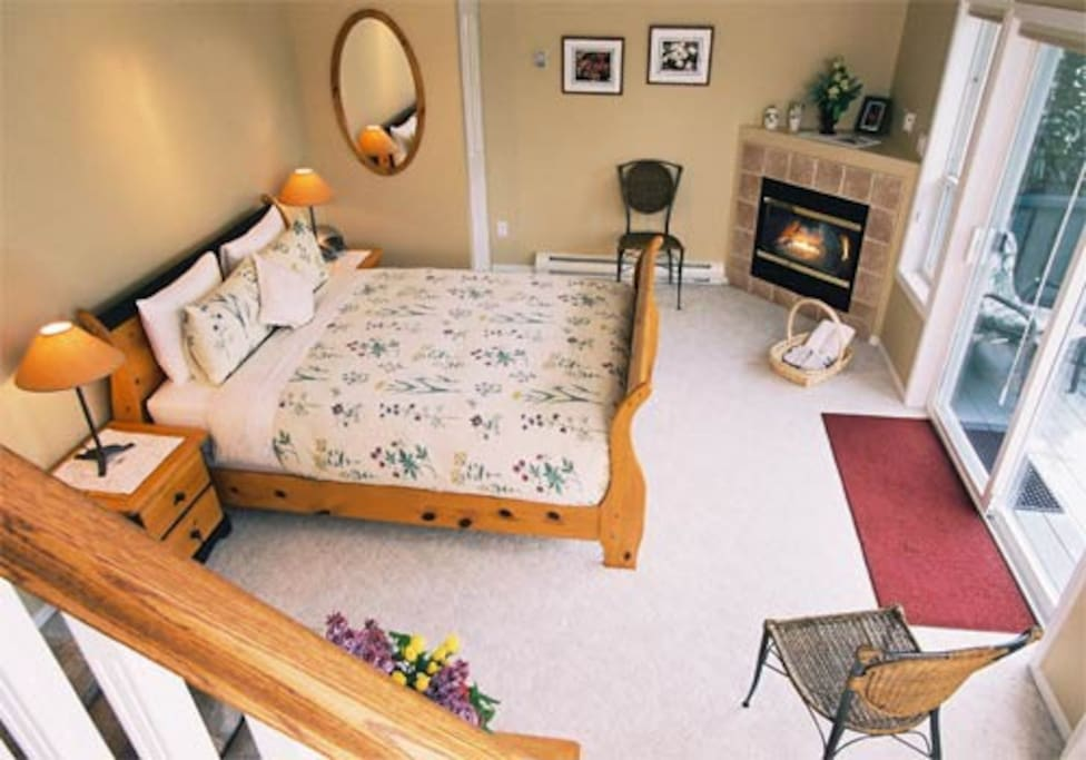 The room leads to balcony, hot tub and garden