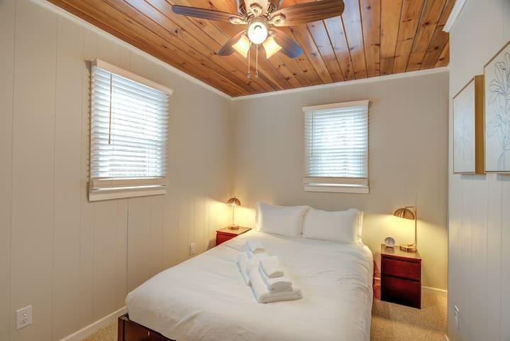 Queen bedroom (up) overlooks the firepit.  Premium cotton linens in each room.