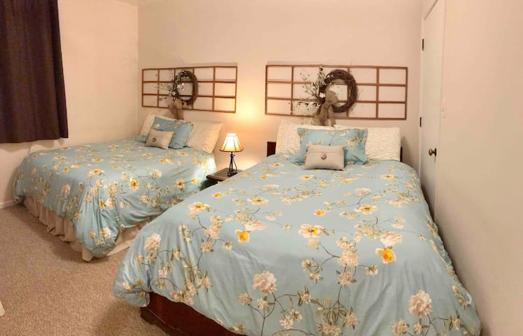 The Cotton Blossom room of the Hatton Ferry Hideaway features 2 cozy double beds