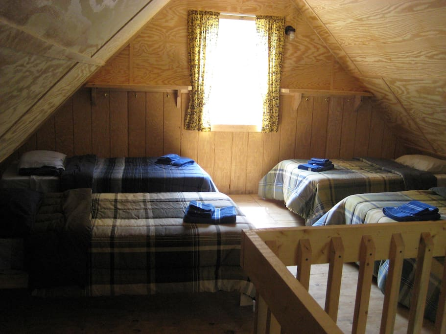 Upstairs has 6 twin beds. This is not a loft, it is an actual second floor. Second floor is air conditioned as well. We supply all bedding.