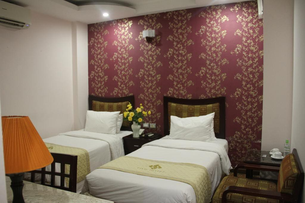 Superior twin room: Room size 17 m² Room facilities:  • Shower • TV • Telephone • Air conditioning • Hairdryer • Refrigerator • Desk • Fan • Toilet • Private bathroom • Cable Channels • Bath or Shower • Hardwood/Parquet floors • Wake-up service • Wardrobe/Closet • Bidet • Towels • Upper floors accessible by lift • Clothes rack Free Wifi