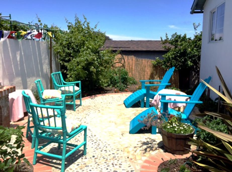 Backyard patio for your enjoyment, tomatoes growing and lots of fresh herbs