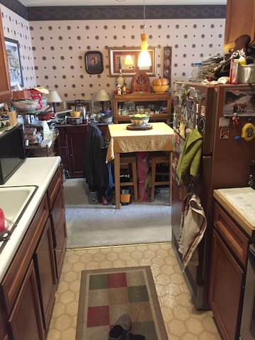 Small galley kitchen and dinette area. Can use fridge and stove.