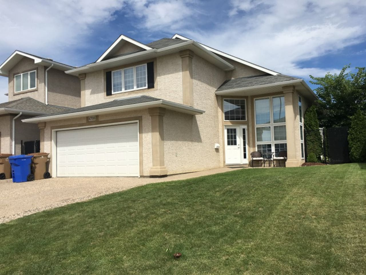 Three levels of comfort and space, a large patio with seating for a dozen people, a big BBQ, and a 2 car garage.