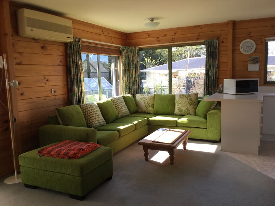Sunny sofa corner next to kitchen