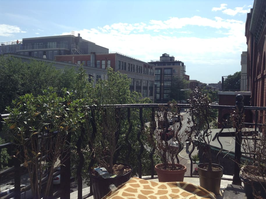 The balcony offers picturesque views of 14th Street in NW DC