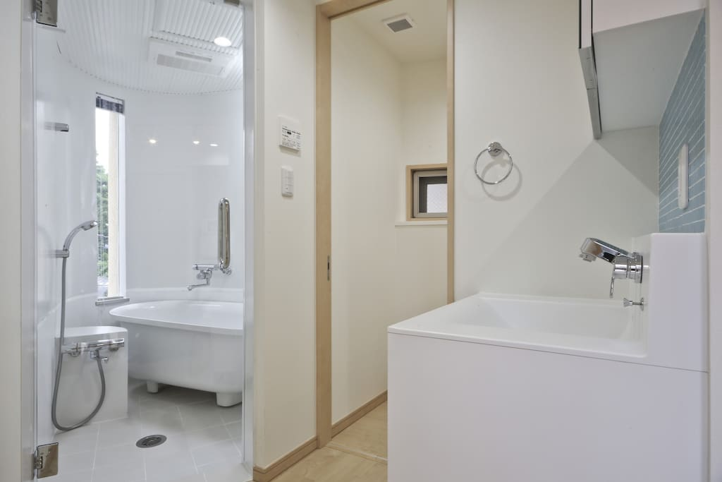 Modern and beautiful Japanese bathroom! There is a curtain over the bathroom door for complete privacy.