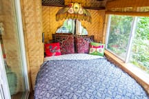 Queen size bed with ceiling fans above