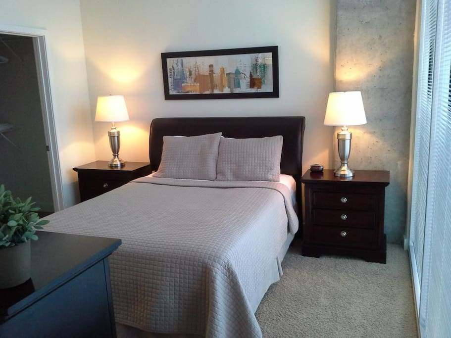 Bedroom with gorgeous views of Uptown Charlotte, Knights stadium and Romare Bearden Park!
