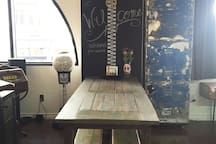 zipper chalk wall over a 6ft oak kitchen table with picnic seating
