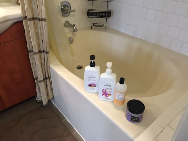 oval tub & shower essentials provided