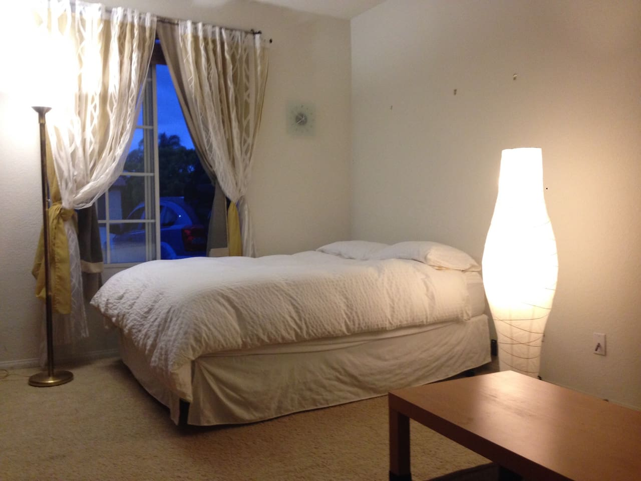 The queen bed is comfortable, and there are blinds and curtains to help you sleep.