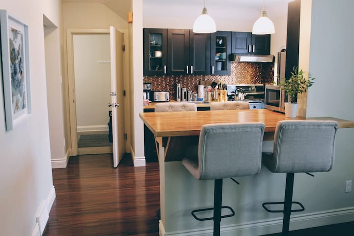Stainless Steel Appliances, with Gas Stove, Pendant Lights with dimmer for mood lighting.