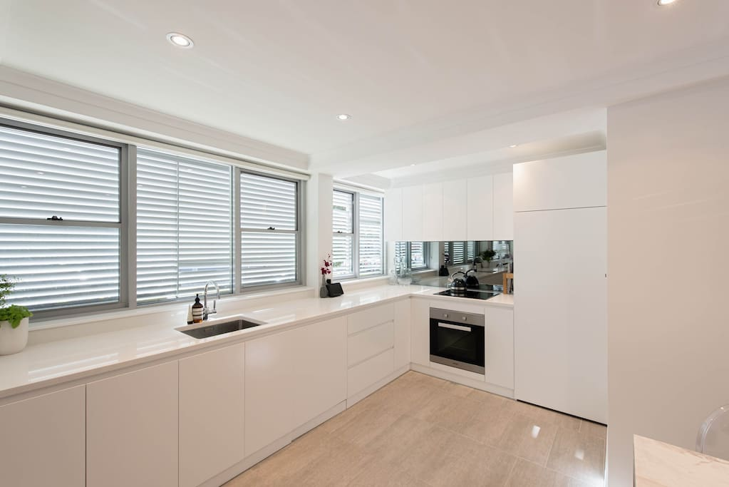 Designer kitchen with architectural fittings and concealed washer/dryer